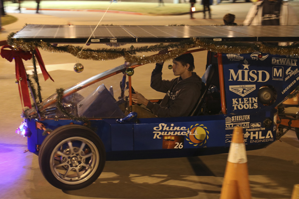 Josh Brown, 12, rides in a car a Ben Barber class built at Toys for Tots. The event will start at 5 p.m. at the Center.