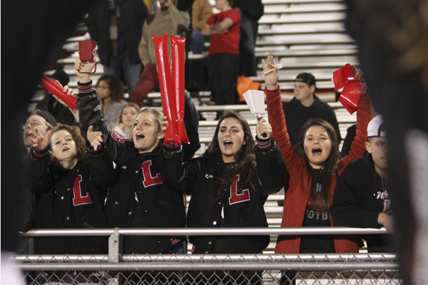 Fans cheer at the last football game on Nov. 16. Legacy lost in the first round of playoffs.