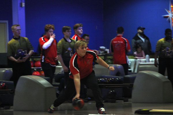 Ty Flores, 12, bowls against Mansfield High School on Dec. 13th.