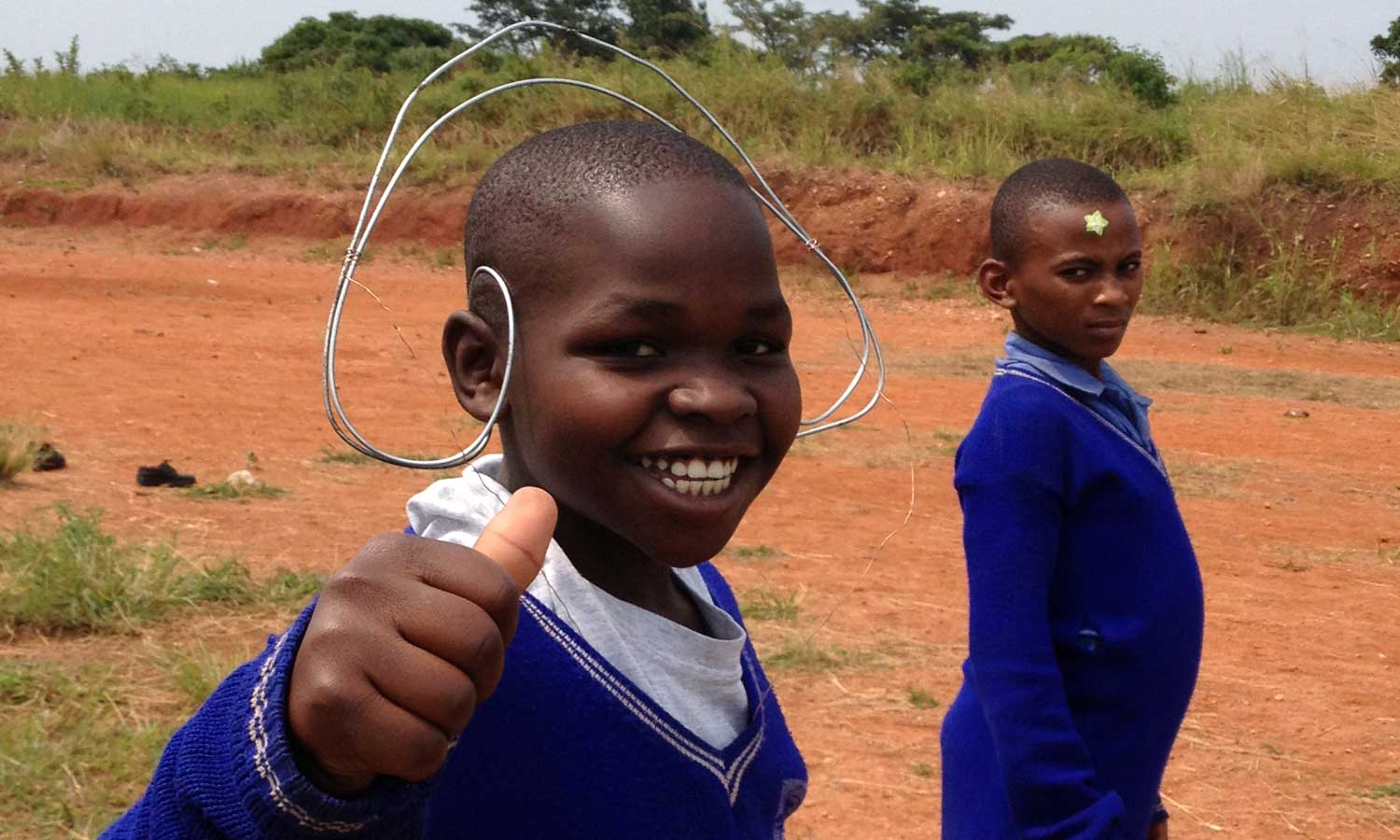 Alex Smith, 10, plays in Uganda as a child during school. Smith moved to the U.S. in 2011.
