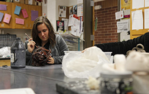 Makenna Jones, 12, works on a project in Ceramics class. Jones joined ceramics