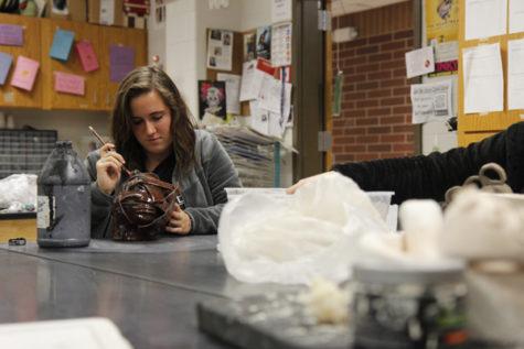 Makenna Jones, 12, works on a project in Ceramics class. Jones joined ceramics