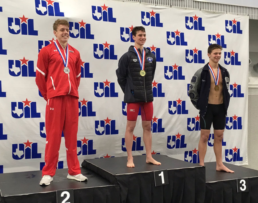 Eric Stelmar, 11, on the podium after coming second in the 100m backstroke at the state meet.