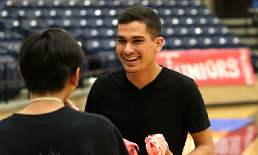 Orlando Morales, 12, discusses how to set up a pep rally with a fellow Student Council member.