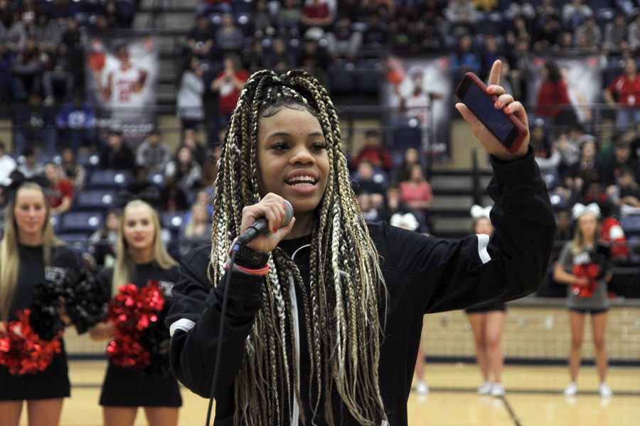 Harmoni Turner, 11, talks about the upcoming girls varsity basketball game against Timberview.  (Conner Riley photo)