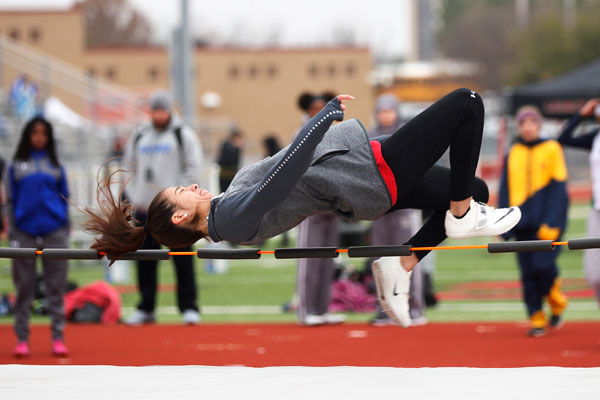 Ana Copland, 9, practices during warmups for high jump. (Conner Riley photo)