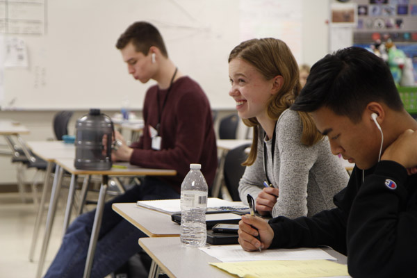 In Mr. Davis' room, juniors  Megan Novak and Justin Pham study for the state competition.