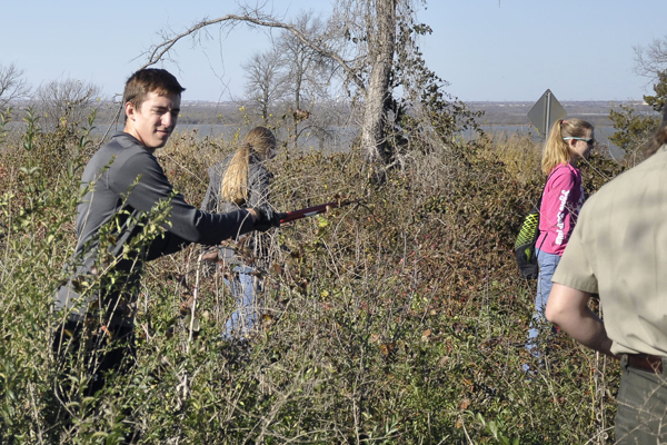 Members of the National Honor Society help clean up the Cedar Hill park on Dec. 1.