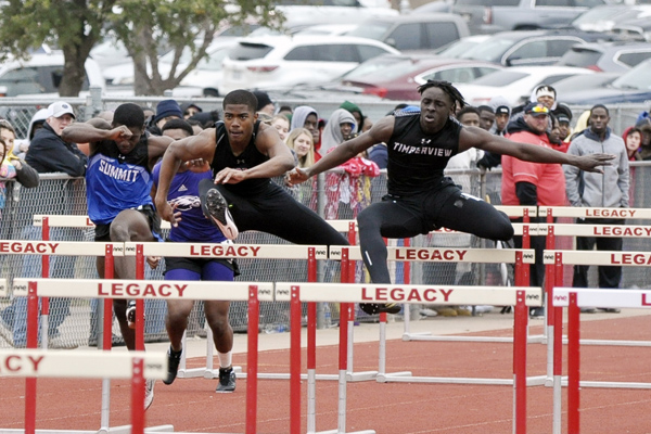 Tru Edwards, 12, jumps over a hurdle on at the track meet on Feb. 16. The team hopes to make state like last year.