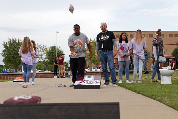 Clyde Davis, 12, throws a bean bag during a game of cornhole. The westside picnic took place on April 16 and Legacy feeder schools attended.
