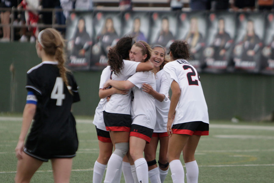 The team celebrates in the final seconds of their game against Aledo. They defeated Aledo 1-0.