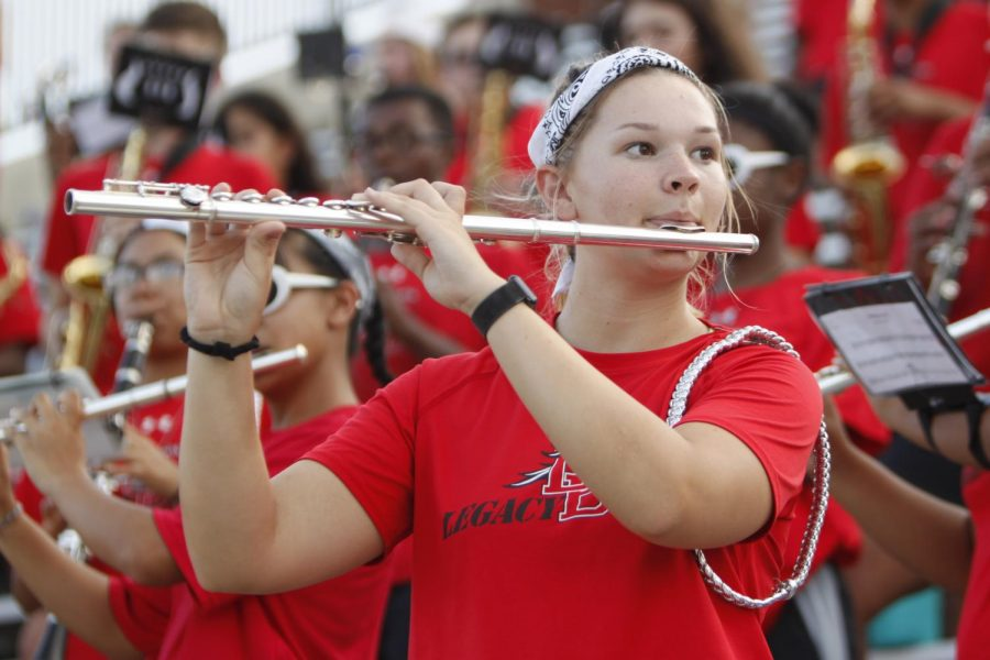 Sophie Henry, 12, plays the flute in the stands. (Conner Riley photo)