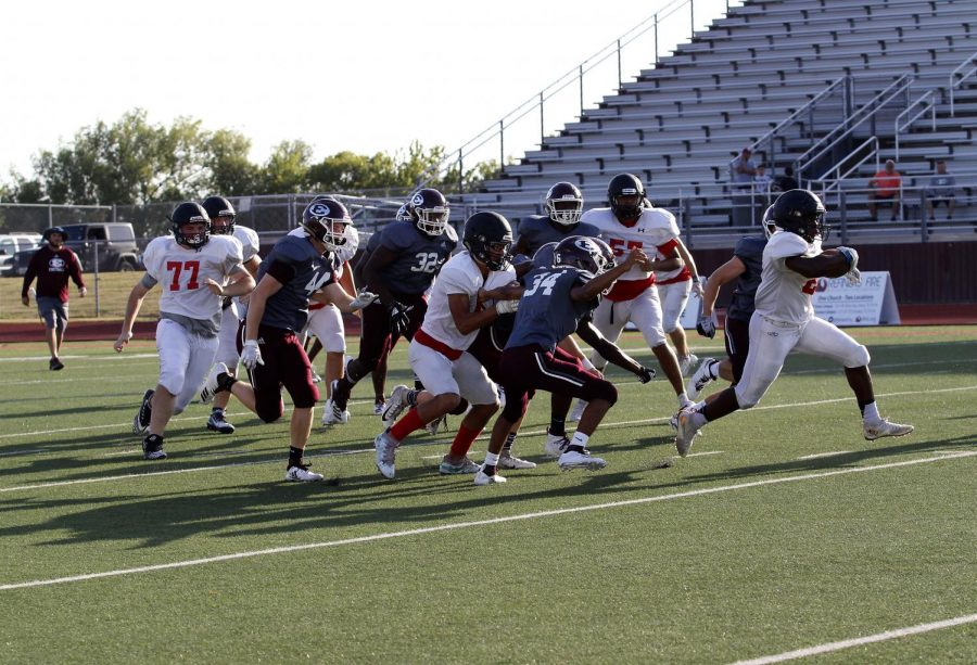 Varsity Football plays against Ennis High School in scrimmage on Aug 22.