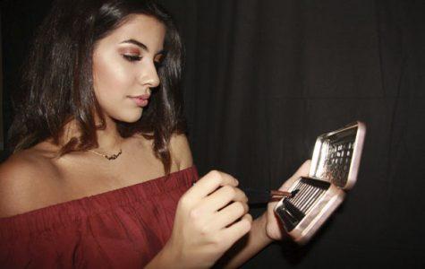 Serena Noureddine, 11, applies powders. Noureddine promotes and sells makeup brands.