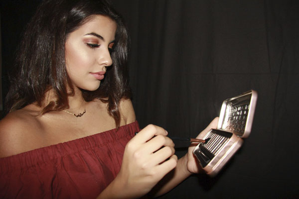 Serena Noureddine, 11, applies powders. Noureddine promotes and sells makeup brands.