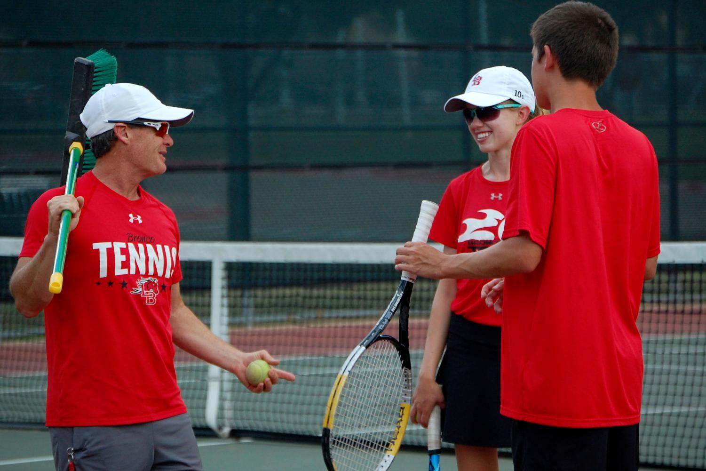 Coach Chad Redwine jokes with Megan Novak, 12, before the match. (Brooklyn Hilmes photo)