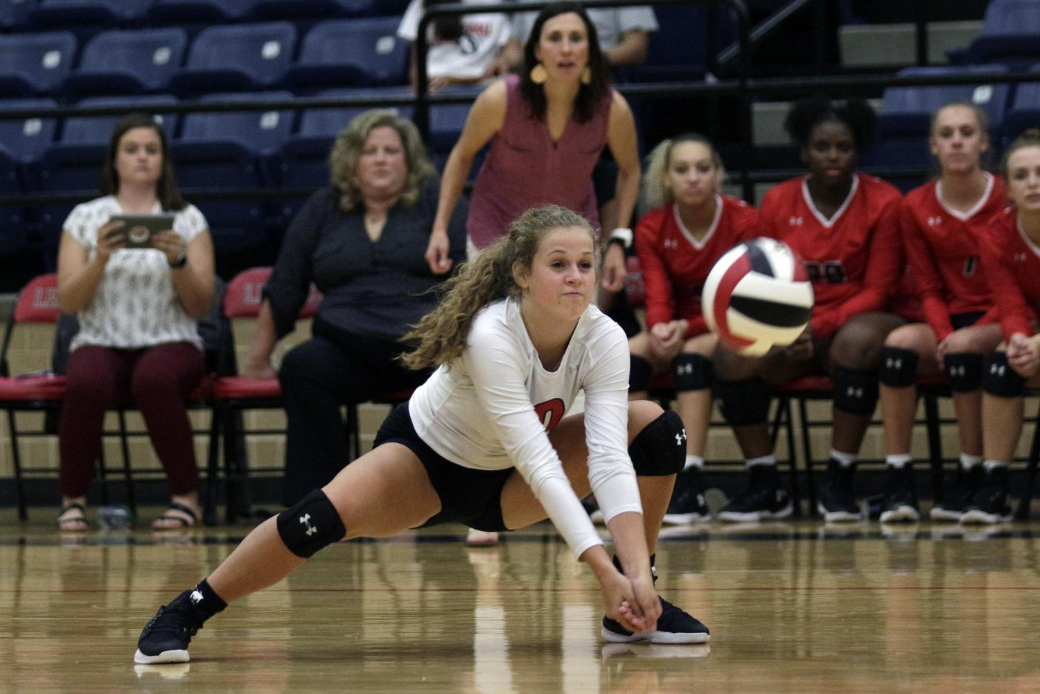 [File photo] Payton Hyden, 11,  digs the ball at a varsity volleyball game.