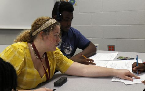 Ms. Alissa Alfaro works with students on an assignment. Alfaro is one of 32 new teachers this year.