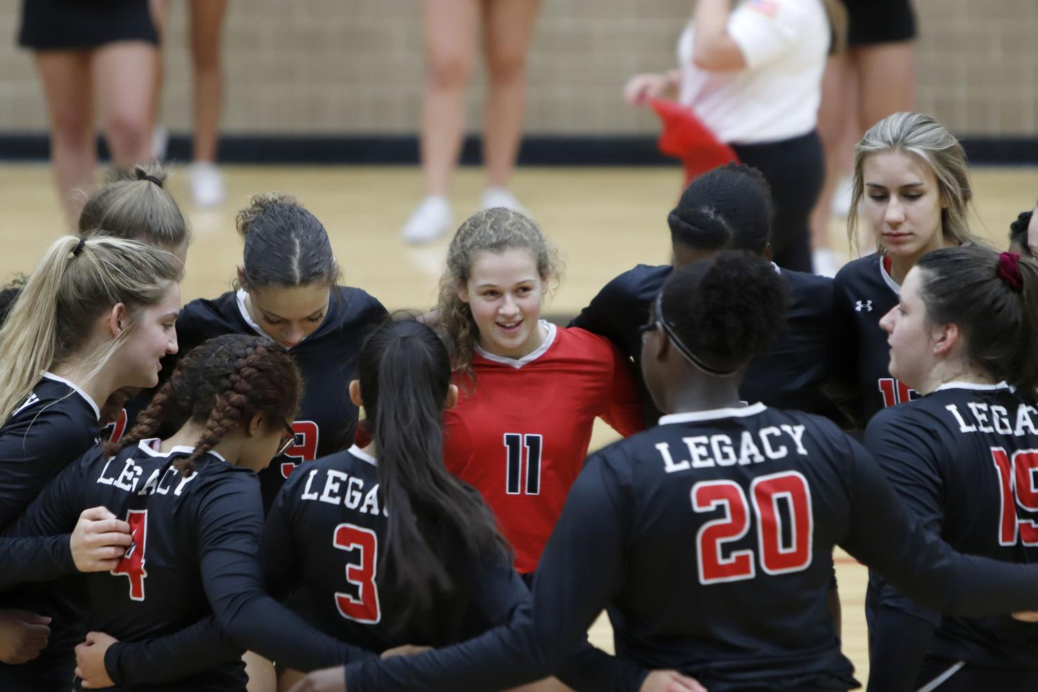 Payton Hyden, 11, and teammates huddle during game against Everman on Sep. 20.