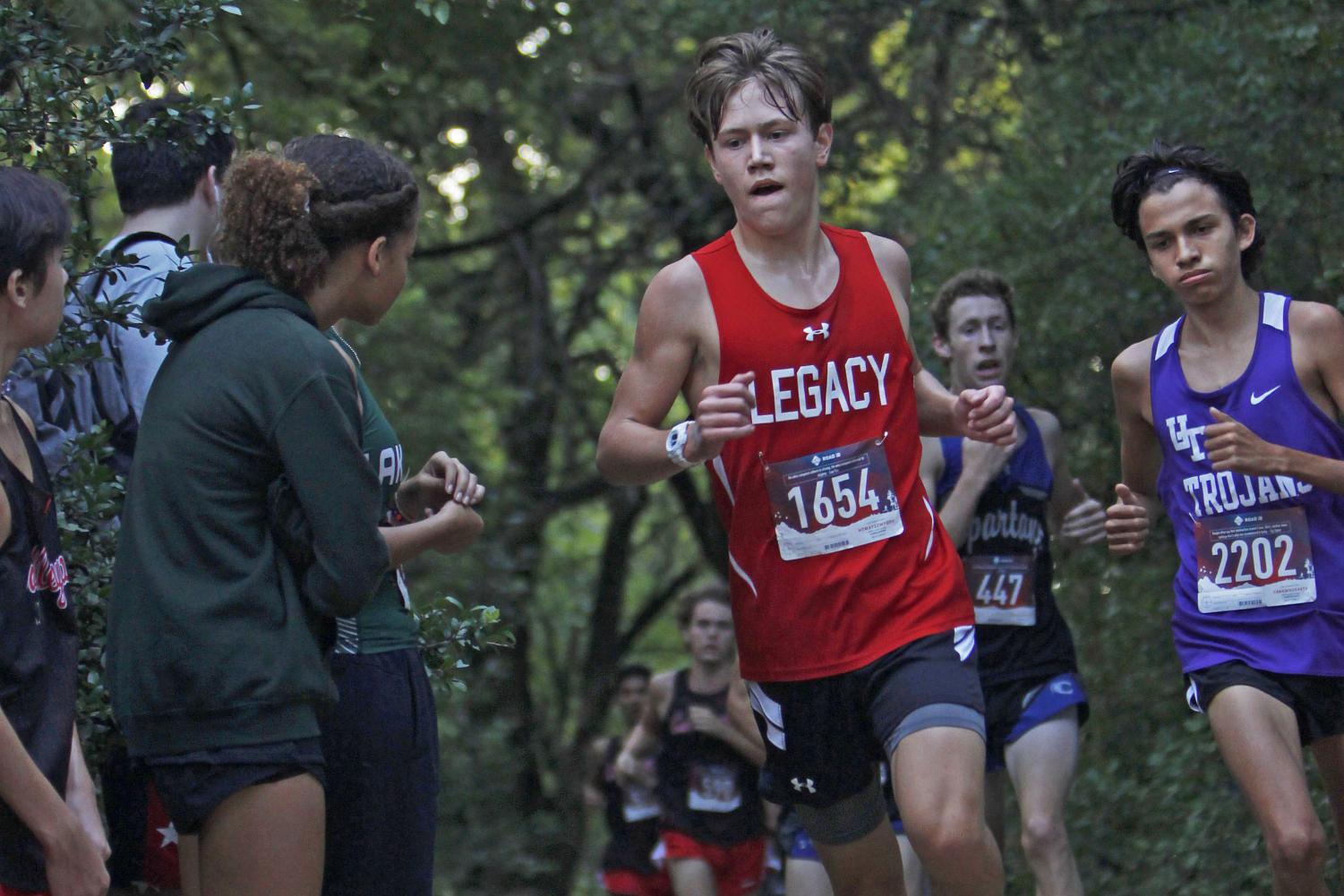 Ethan Elston, 11, runs at the Burleson Invitational on Aug. 30