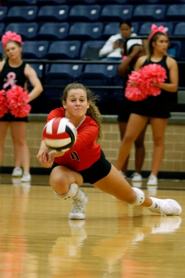 Payton Hyden, 11, digs for the ball during the game against Crowley. (Conner Riley photo)