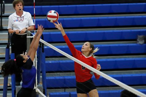 Alexandria Gentry, 11, tips the ball over the net against Everman. (Seth Miller photo)