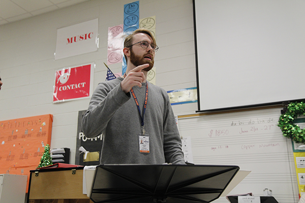 Patrick Casey rehearses with Men's Ensemble for the choir concert.