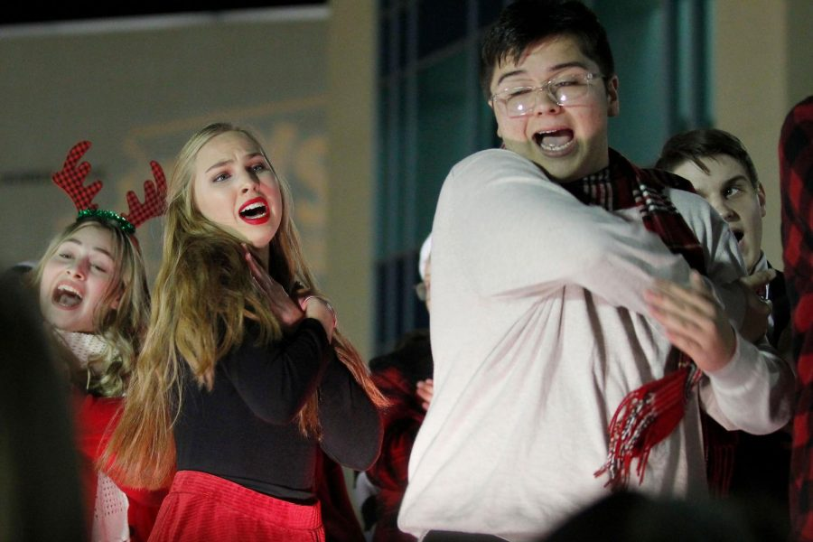 Show choir students Stacie Morton, 12, and Caiden Reisinger, 10, perform their Christmas performance. (Madison Gonzales photo)