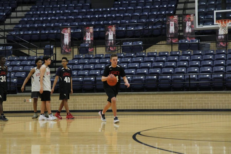 Robert+Bradley%2C+9%2C+dribbles+the+basketball+during+a+game.+Bradley+plays+basketball+despite+missing+a+rib.+