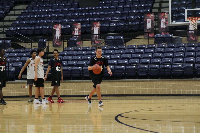Robert Bradley, 9, dribbles the basketball during a game. Bradley plays basketball despite missing a rib.