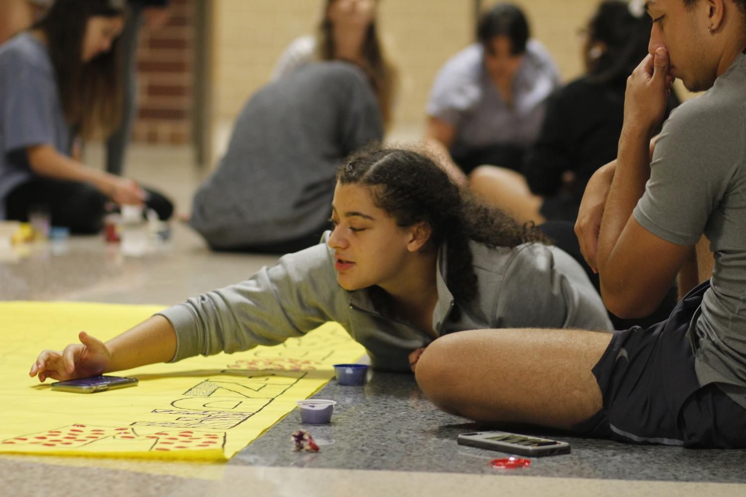 Christine Holley, 12, decorates posters for homecoming with other members of student council. StuCo will host the TASC conference in 2021.