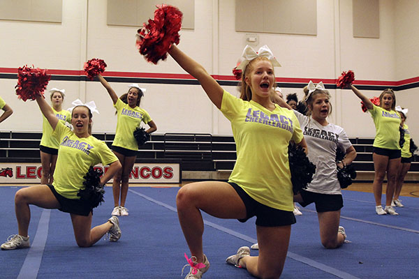Claire Wisdom, 10, poses during rehearsal. Cheer placed seventeenth in the UIL Spirit Group competition.