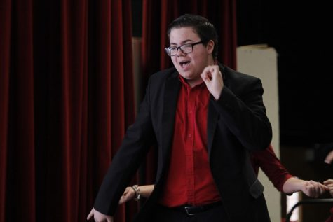 Senior Cyle Brown performs with the show choir during their Holiday Tour.