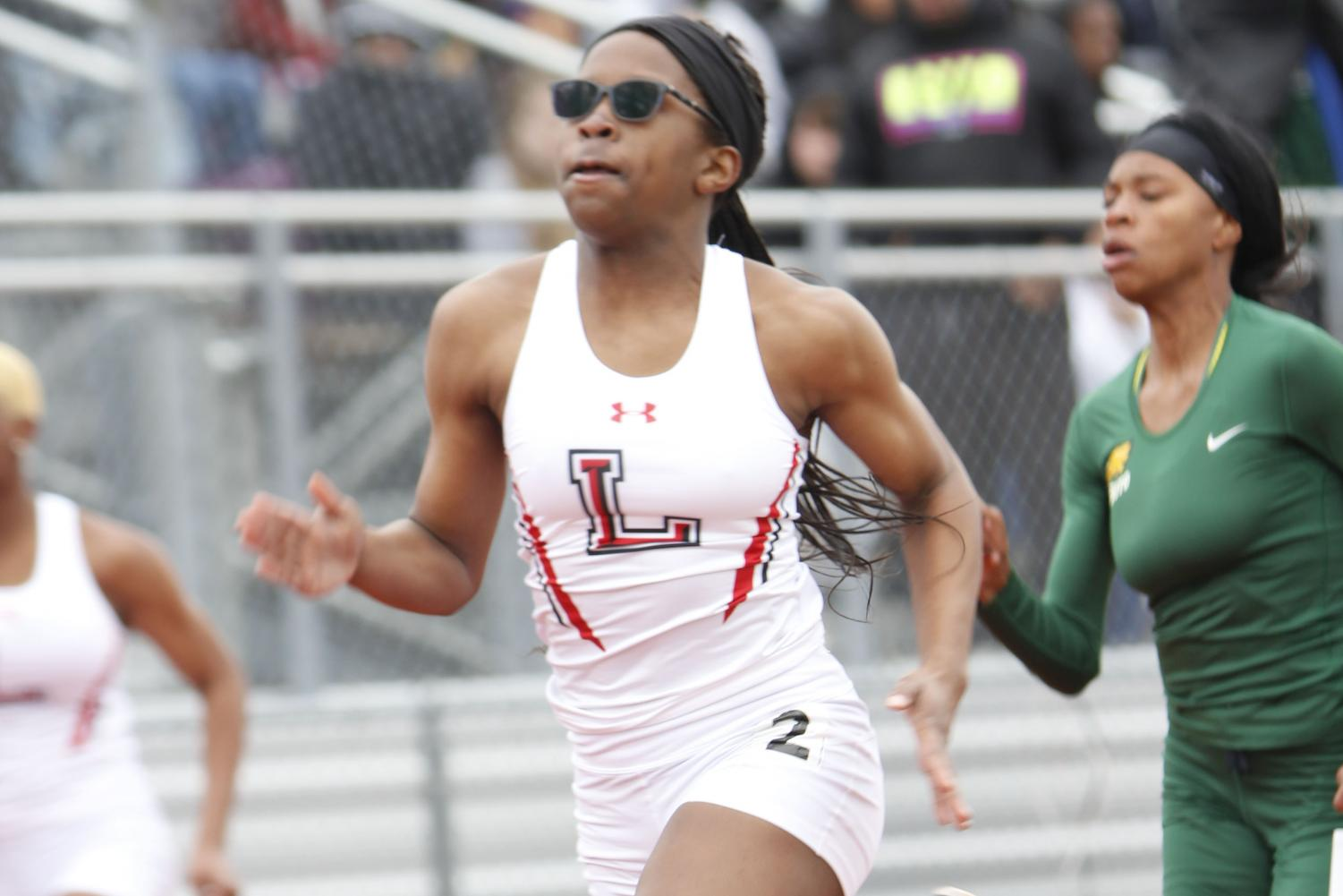 Christine Mallard, 10, competes at track meet in 2018-19 season.