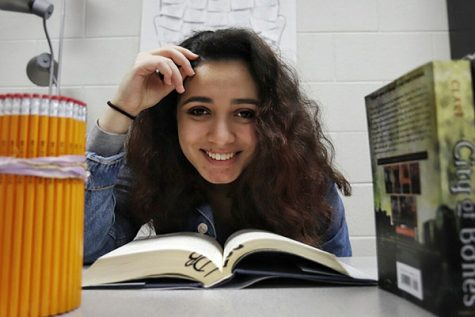 Lana Abdularezeq, 11, poses for a picture in Mrs. Bennett's classroom. Abdularezeq is the unofficial Vice President of author's club.