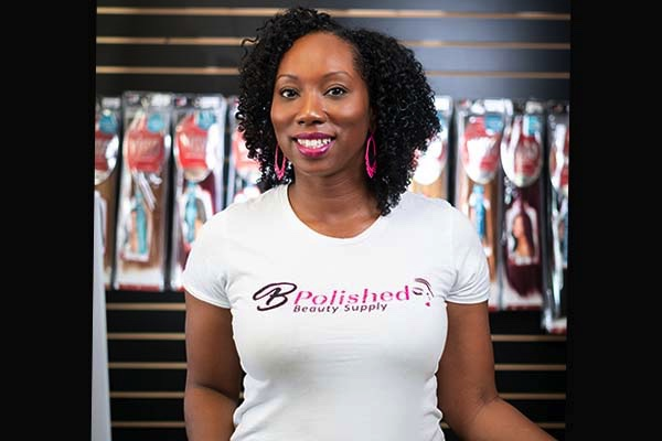 B Polished owner  Frankesha Watkins stands behind the checkout counter at her store.