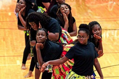 African Student Union performs at the Black Out pep rally. Tracy Adu (second from the front) danced during the event.