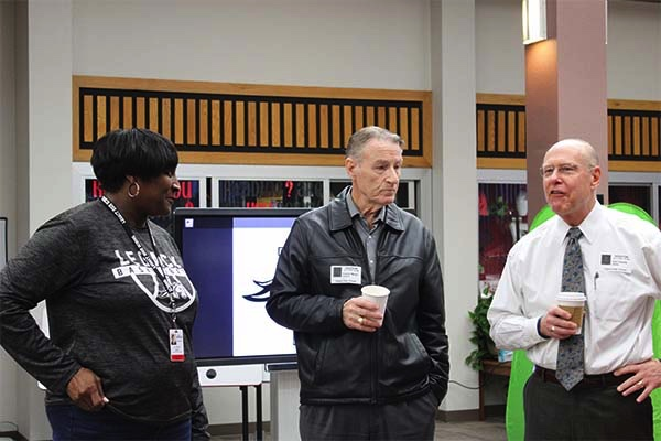 Dr. Butler (left) speaks with school board members at the breakfast hosted by StuCo.
