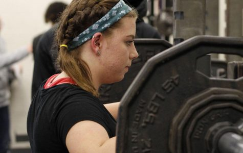 Johanna Leduc, 11, prepares to squat at Legacy's powerlifting meet on Feb. 5.