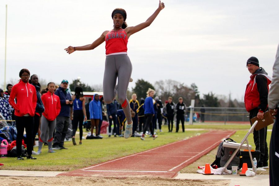 Rachel Darden, 12, jumps into the pit during long jump at the Bronco Relays on Feb. 22.