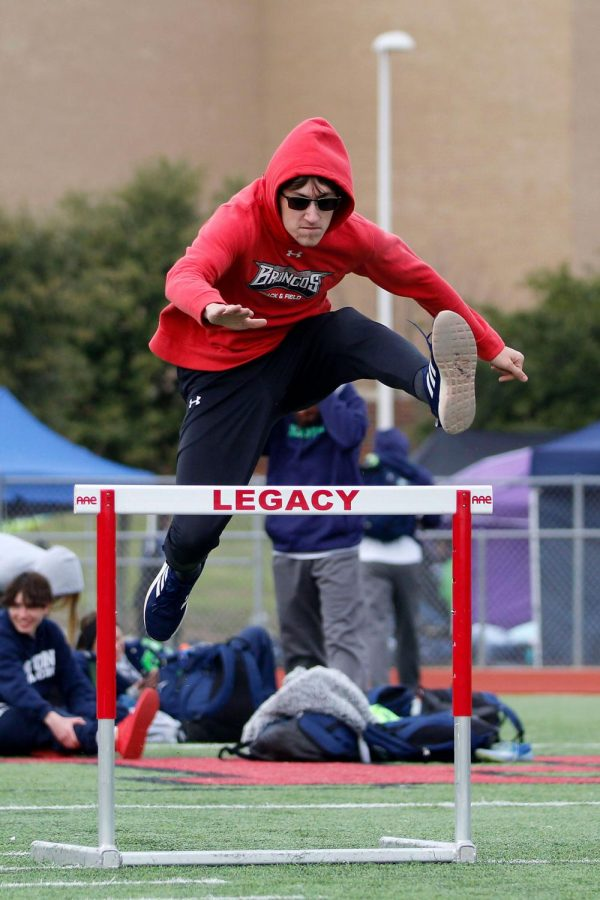 Tyler Sims, 10, warms up on hurdles. (Madison Gonzales photo)