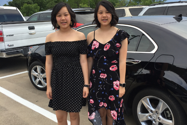 Sivong and her twin sister pose in the ACA parking lot before their eighth grade graduation.