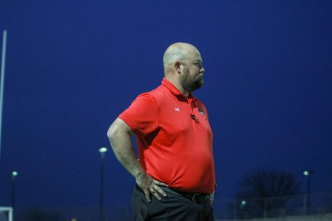 Coach Michael Keel observes his players during a varsity game.