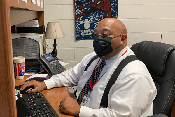 Assistant Principal Alcorn reads emails in his office during 4th period.