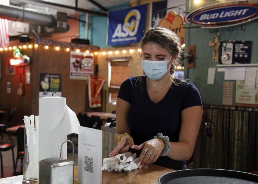 Emarie Wachsmann, 12, organizes cutlery at Stevens Garden and Grill.