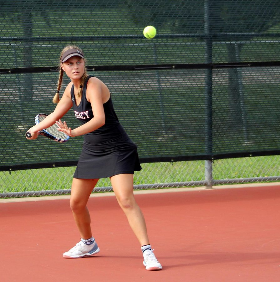 Tatum Sikes,11, hits a forehand in the varsity tennis match against Duncanville on Sept. 11.