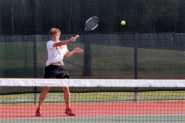 Freshman Jantzen Redwine hits the ball in the match against Burleson Centennial.