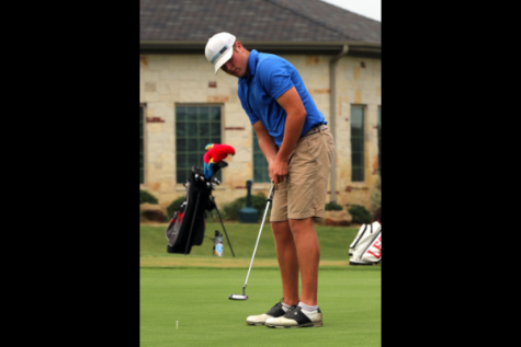 Ty Maxwell, 12, practices his putting on the green.
