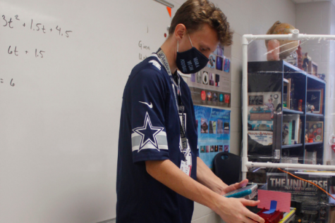 Junior Andrew Bobe participates in a lab in his  physics class.
