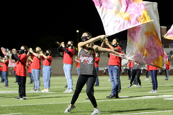 Colorguard member Gabriel Farley, 12, dances at the at the MISD Band Showcase on Nov. 16.